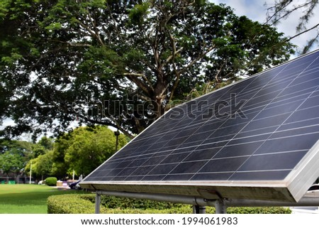 Rectangular solar panel in two meters long and one meter wide size was installed in the public park  to store sunlight energy in battery and use it with street lights around the public park at night.