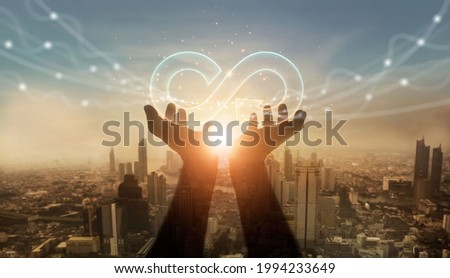 Businessman hold circular economy icon. Sustainable strategy approach to eliminate waste and pollution for future growth of business and environment, design to reuse and renewable material resources.  Royalty-Free Stock Photo #1994233649