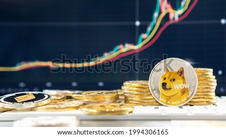Dogecoin, Doge coin cryptocurrency, digital crypto currency tokens for defi decentralized financial mobile banking p2p global investment and financial business stock market technology Royalty-Free Stock Photo #1994306165