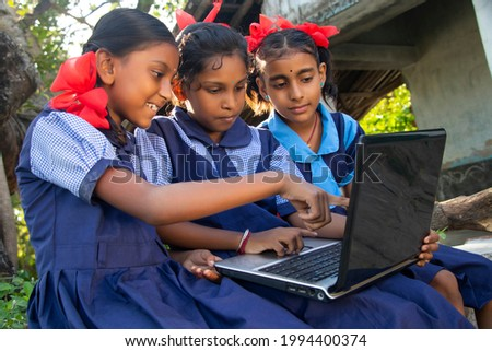 indian village government school girls operating laptop computer system at rural area in india Royalty-Free Stock Photo #1994400374