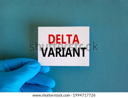 New covid-19 delta variant strain symbol. Doctor hand in blue glove with white card. Concept words 'delta variant'. Medical and COVID-19 delta variant strain concept. Copy space.