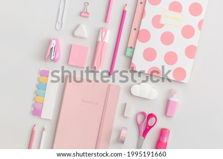 Pink school stationery on a grey background. Top view. Flat lay. Back to school concept. Royalty-Free Stock Photo #1995191660