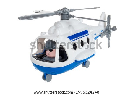 Toy helicopter with pilot close-up isolated on white background, children's toy