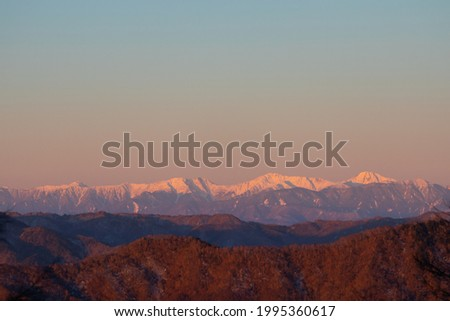 Morning of the Southern Alps as seen from Mount Kumotori Royalty-Free Stock Photo #1995360617