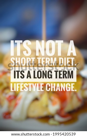 """Inspirational quote of eating healthy """"ITS NOT A SHORT TERM DIET. ITS A LONG TERM LIFESTYLE CHANGE."""" isolated on a food background."""