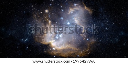 A view from space to a galaxy and stars. Universe filled with stars, nebula and galaxy,. Panoramic shot, wide format. Elements of this image furnished by NASA. Royalty-Free Stock Photo #1995429968