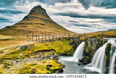 Waterfalls in the mountain valley. Mountain waterfall landscape. Waterfalls in mountains. Mountain falls Royalty-Free Stock Photo #1995434873