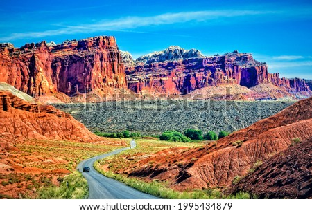 Canyon road in mountains. Red sand canyon road landscape. Mountain road in canyon Royalty-Free Stock Photo #1995434879