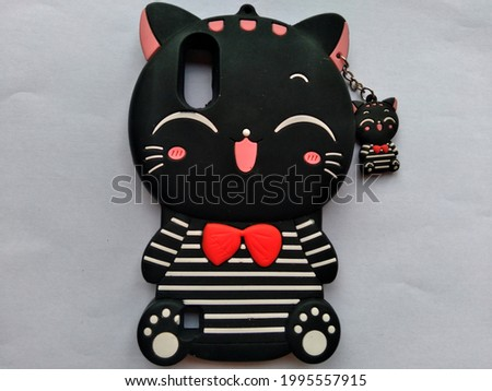 Cute character phone softcase in the form of a cute cat in black with a black and red kitten hanger