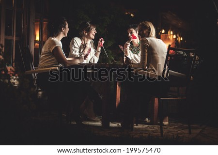 Four attractive women night out having dinner in a restaurant  #199575470