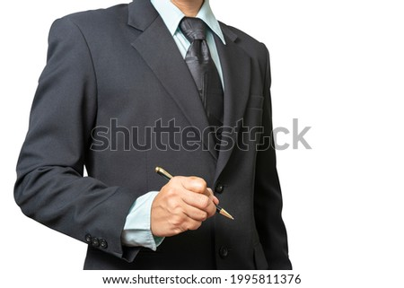 Portrait business man wearing a black suit stand and hold pen for writing or drawing isolated on white background with clipping path (select focus at hand)