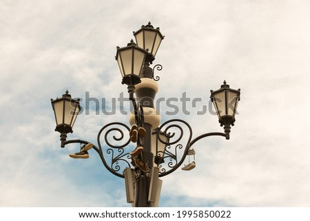 Perfect picture of cloudy bright day and chandelier with the shoes on top