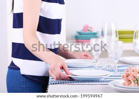 Woman laying table in room #199594967