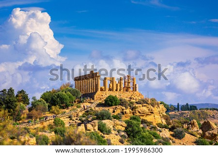 The greek temple of Juno in the Valley of the Temples, Agrigento, Italy. Juno Temple, Valley of temples, Agrigento, Sicily. Royalty-Free Stock Photo #1995986300