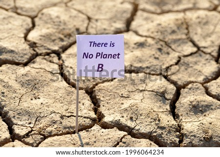 There is no planet b banner on arid cracked soil. Concept of climate change or global warming. Royalty-Free Stock Photo #1996064234