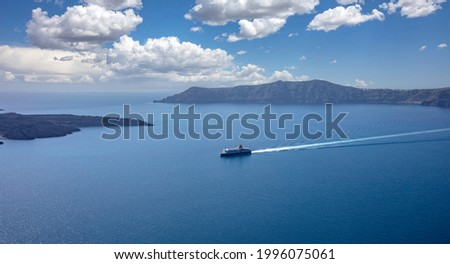 Ferry boat with destination Greek cyclades, Santorini island, Cyclades, Greece. Blue Aegean sea and sky background, summer vacation cruise travel tourism. Royalty-Free Stock Photo #1996075061