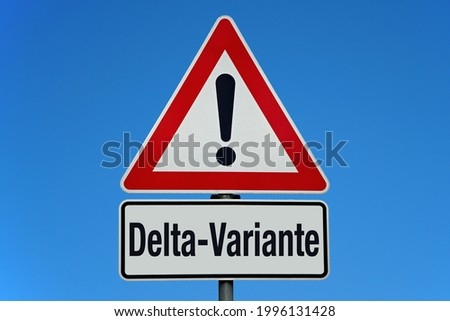 Warning sign with sky and german word for covid-19 delta variant