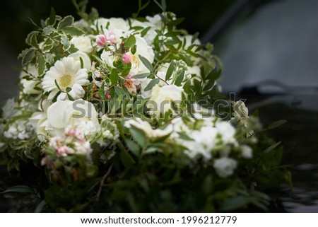 A closeup shot of decorative white bouquets on a car Royalty-Free Stock Photo #1996212779