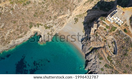 Aerial drone photo of small secluded cove and beach of Sparagario below iconic castle of Kythira island main village, Ionian, Greece