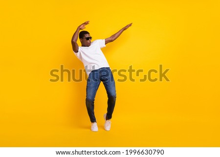Full length body size view of attractive cheerful guy dancing pout lips having fun isolated over bright yellow color background Royalty-Free Stock Photo #1996630790