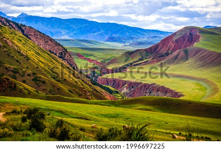 Green hills in a mountain valley. Mountain valley landscape. Green mountain valley. Mountain landscape