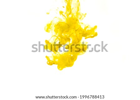 Bright yellow acrylic paint swirling in water. Ink moving in liquid creating abstract clouds. Traces of colorful dissolving in water, changing shape. Abstract decorative creative background.