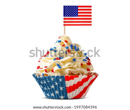 Cupcake. American Flag. US Holidays. Cake on 4th of July, Independence, Presidents Day. Tasty cupcakes with white cream icing and colored stars sprinkles. USA patriotism. Sweet dessert.