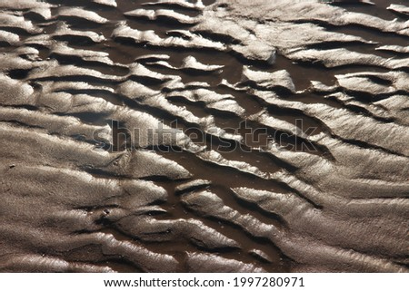 texture of golfing on the sand of Katwijk beach in the Netherlands