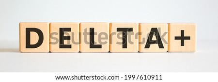 Covid-19 delta plus variant symbol. Wooden cubes with words Delta plus. Beautiful white background. Copy space. COVID-19 new delta plus variant concept.