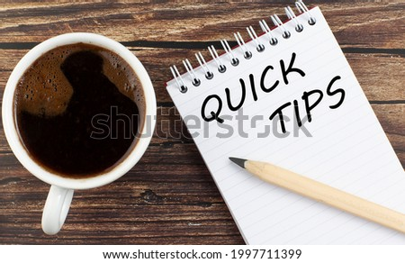 QUICK TIPS text on notebook with coffee on the wooden background