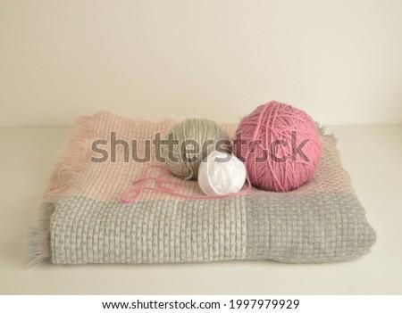 pastel woolen balls on winter scarf