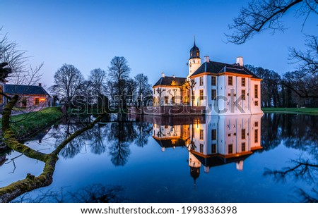 Pond island manor in the late evening. Manor pond. Evening manor pond. Pond reflection Royalty-Free Stock Photo #1998336398