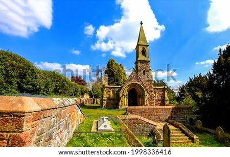 Old stone church and cemetery. Cemetery church. Church on cemetery. Old cemetery church Royalty-Free Stock Photo #1998336416