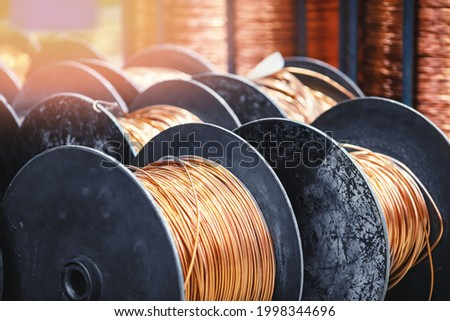 Copper coil cable spool on factory, warehouse factory wire. Royalty-Free Stock Photo #1998344696