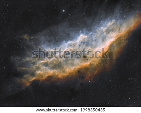California nebula,The California Nebula (NGC 1499) is an emission nebula located in the constellation Perseus. Royalty-Free Stock Photo #1998350435