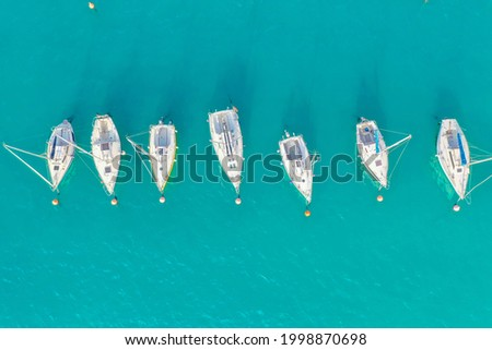 Top view of boats and yachts in the marina from above. Marina, Marina, Yacht and sailboat are moored to the pier. Aerial view by drone. Italy, sunny coast Royalty-Free Stock Photo #1998870698