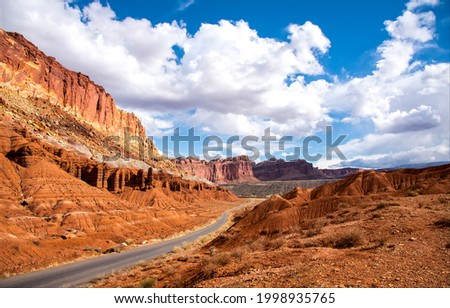 The road through the canyon on a clear day. Red rock canyon road in mountains. Canyon road landscape. Mountain road panorama Royalty-Free Stock Photo #1998935765