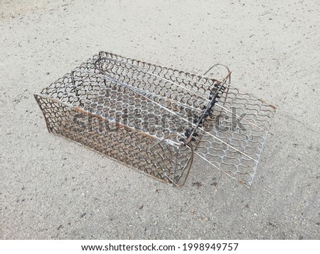 This is a photo of mouse trap cage. This picture take from a home at Terengganu, Malaysia. This trap are ideal to catch chipmunk, mouse, rat, and other small size animal. It is lightweight but durable