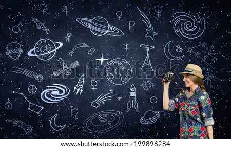 female photographer with retro photo camera over space pattern