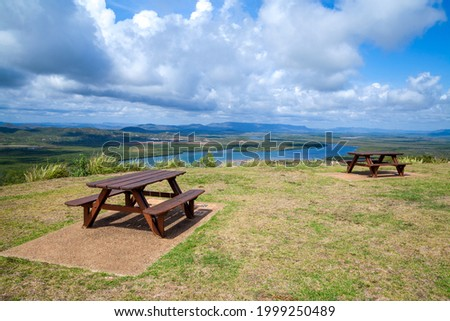 A place to relax and picnic at the top of the hill with gorgeous panoramic views of the rainforests, lagoon and mountains in the distance.Two wooden picnic table tables.Great recreation area.