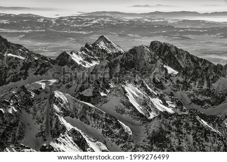Panoramic view on Majestic High Tatras. Dramatic Black and White photo of mountains. Slovakia.