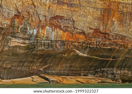 Abstract landscape of mineral stained cliff along the eroded sandstone shoreline of Lake Superior, Pictured Rocks National Lakeshore, Michigan's Upper Peninsula, USA