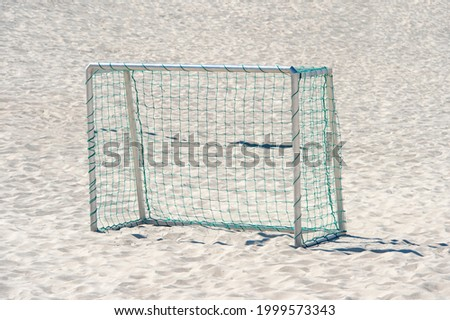 Soccer gate with net on sand. Professional sport concept
