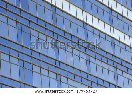 Clouds reflected in windows in the office building #199963727