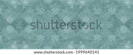 Old white green vintage worn shabby elegant damask rue diamond floral leaves flower patchwork motif tiles stone concrete cement wall wallpaper texture background banner Royalty-Free Stock Photo #1999640141