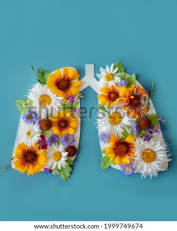 lungs with flowers and leaves on a blue background. world tuberculosis day, world no tobacco day, lung cancer, Pulmonary hypertension, Pneumonia, copd, eco air pollution, organ donation, respiratory Royalty-Free Stock Photo #1999749674