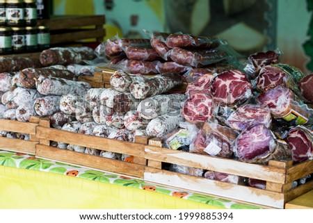 Salamis and sausages at an italian market Royalty-Free Stock Photo #1999885394