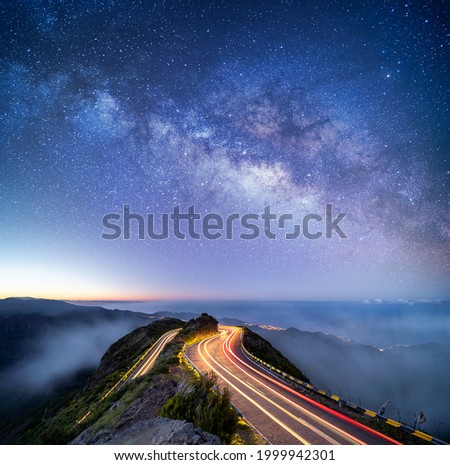 Astrophotography shot of hairpin turn with galactic core milky way rising on Madeira Island, Portugal Royalty-Free Stock Photo #1999942301