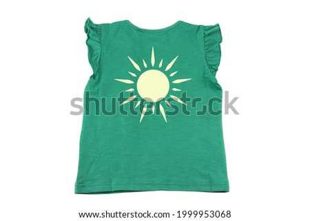 Kids shirt isolated. A fashionable for little girls colourful green sleeveless t-shirt with a print of a sun isolated on a white background. Concept summer fashion for children.