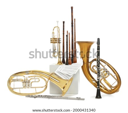 Set of wind musical instruments on white background Royalty-Free Stock Photo #2000431340